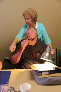Vision Rehabilitation Teacher Jane Bush demonstrates how bright lighting can boost contrast and magnification and make a profound difference for someone who has low vision.