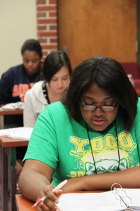 Cordise Thomas reads a passage to her peers in group 3 during a YLF small group exercise.