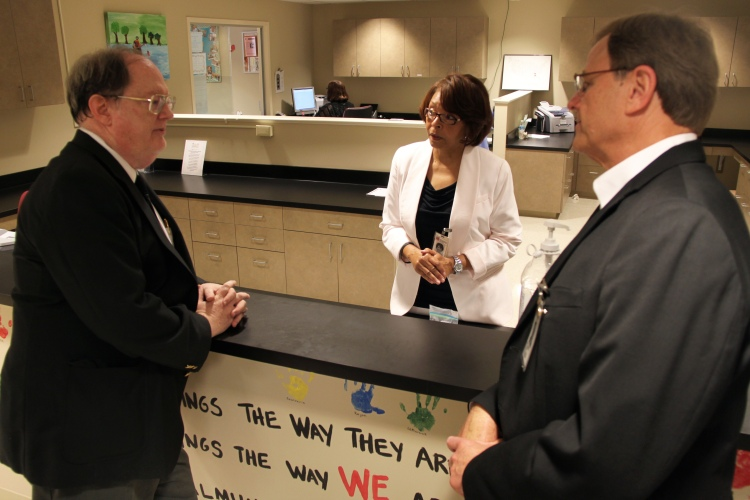 David White, health policy adviser to Gov. Robert Bentley, speaks with ADRS Commissioner Cary Boswell and Assistant Commissioner Melinda Davis during a visit to the Montgomery CRS clinic.