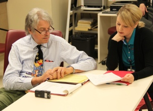 Dr. Paul Maertens, pediatric neurologist, looks over his notes in the CRS seizure clinic