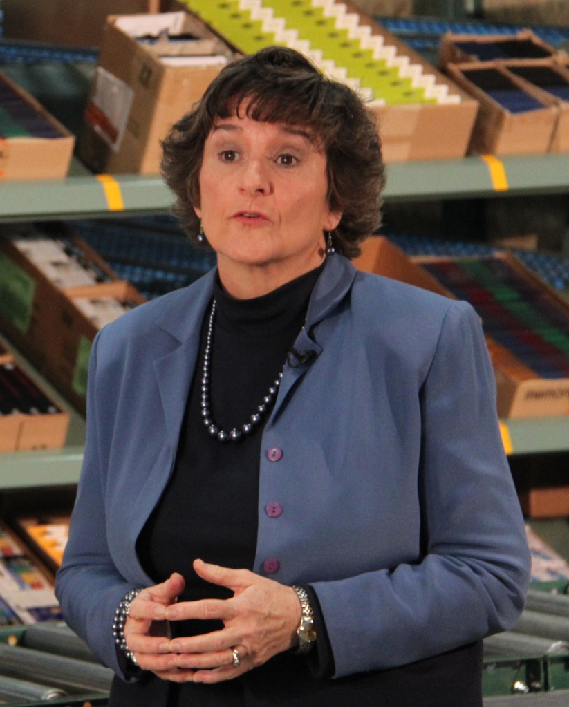 In this file photo, Peggy Anderson, state coordinator of business relations, discusses the partnership between ADRS and OfficeMax (now Office Depot/OfficeMax).