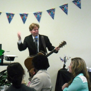Adam Guthrie, a Tuscaloosa musician, performs a song at the party which he specifically wrote for the students