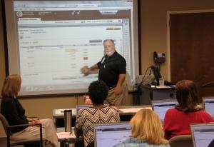 ADRS IT Systems Specialist Buck Jordan leads a staff training session on eSTART
