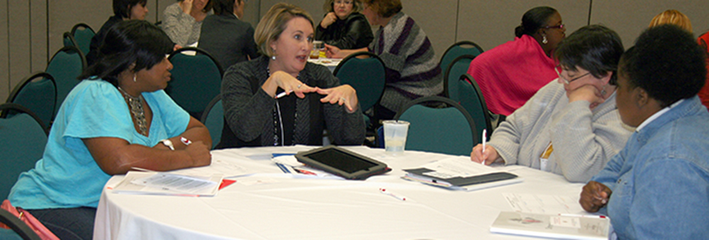 Conference attendees participate in the group activity during the Family Voices of Alabama session, 'Dream Weavers: Tips for Developing the Supports Your Family Needs'