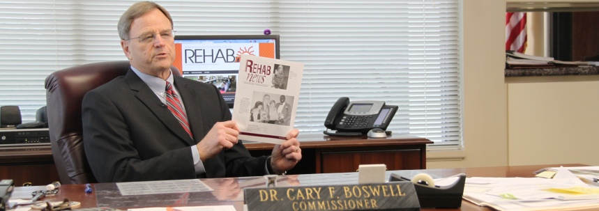 Commissioner Boswell shows the stark difference between the last printed quarterly and the new interactive Rehab news.