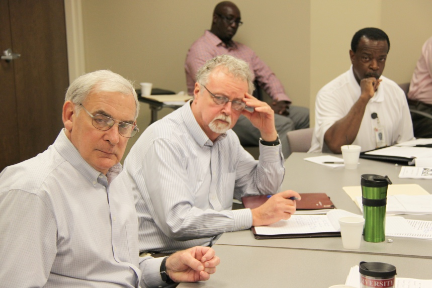 Jim Harris III, Curtis Glisson, and James Myrick all listen to members of FLT during their final meeting before Harris's retirement.