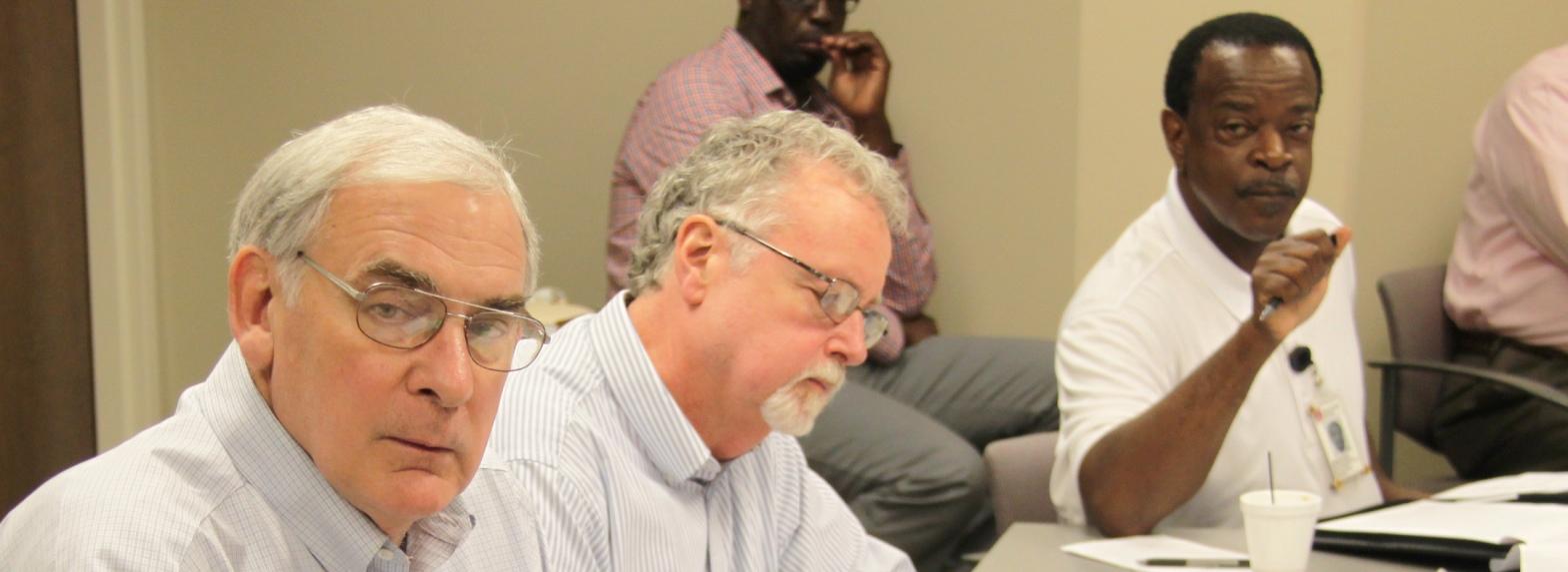 Jim Harris III, Curtis Glisson, and James Myrick speak during a summer meeting of field leadership