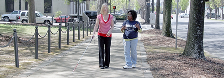 ADRS Orientation and Mobility Specialist Yolanda Smith teaches white cane skills to an individual who is visually impaired