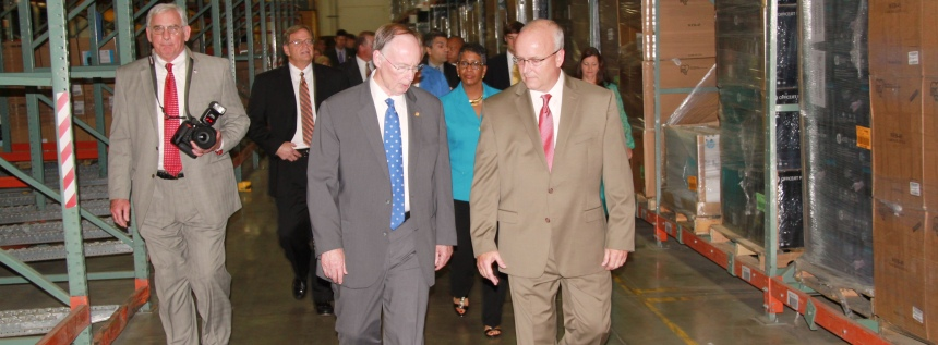 Doug Parks guides Gov. Robert Bentley on a walking tour of the distribution center in McCalla.