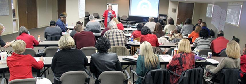 SAIL staff listen as Rehabilitation Specialist Wanda Brady explains a group activity