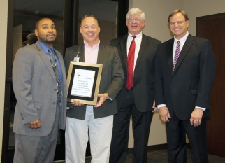 Tuscaloosa VA Medical Center staff accept a certificate from DMH Commissioner Jim Reddoch and ADRS Commissioner Cary Boswell