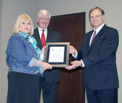 A representative from Shelby Baptist Medical Center accepts the certificate from DMH Commissioner Jim Reddoch and ADRS Commissioner Cary Boswell