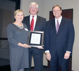 A representative from Thomas Hospital accepts the certificate from DMH Commissioner Jim Reddoch and ADRS Commissioner Cary Boswell