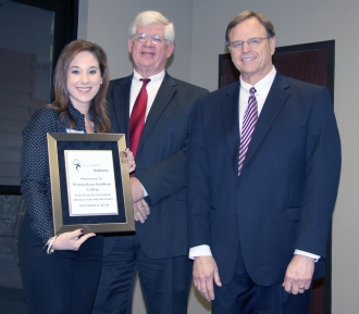 DMH Commissioner Jim Reddoch and ADRS Commissioner Cary Boswell present a certificate to a representative from Birmingham-Southern College