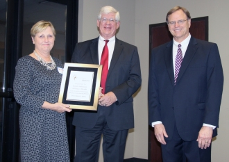 DMH Commissioner Jim Reddoch and ADRS Commissioner Cary Boswell present a certificate to a representative from Mobile Infirmary