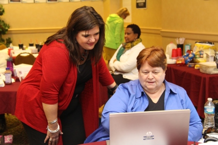 Nicole Pinkham, LTI's lead instructor, assists Linda Fugate during a small group activity.