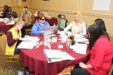 LTI participants discuss leadership techniques in the small group session.