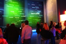 Visitors to the Civil Rights Memorial Center view their names scroll on a wall to represent unity and freedom for all