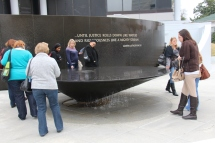 Members of LTI walk around and read names etched into the fountain at the Civil Rights Memorial Center