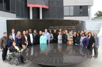 The LTI group gathers around the fountain at the Civil Rights Memorial Center in Montgomery