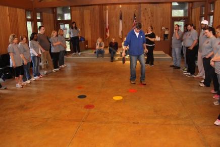 "Luke Dooley, associate executive director at YMCA Camp Chandler, sets up a team building game called ""traffic jam"""