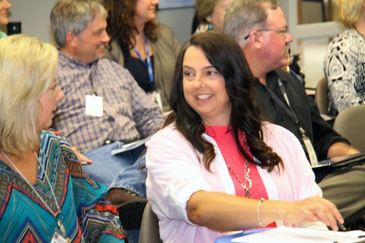 New Jackson CRS Office Coordinator Jennifer Overtreet speaks to new Mobile District Supervisor Tonya Beech at Field Leadership Team (FLT) meeting