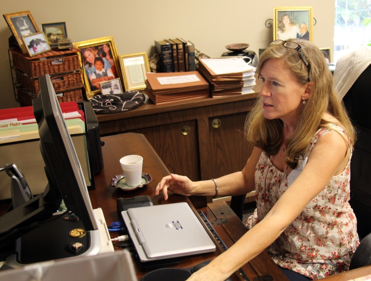 New SAIL Director Lisa Alford reads over data from the Medicaid audit