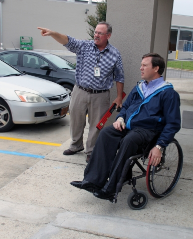 ADRS Rehabilitation Technology Specialist Michael Papp and Graham Sisson, director of the Governor's Office on Disability, discuss the accessibility of the parking lot outside of the Career Center in Cullman
