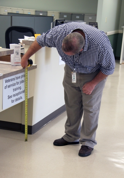 Papp measures the height of a countertop