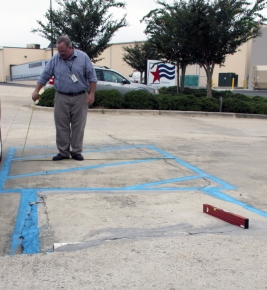 Papp measures the width of an accessible parking spot