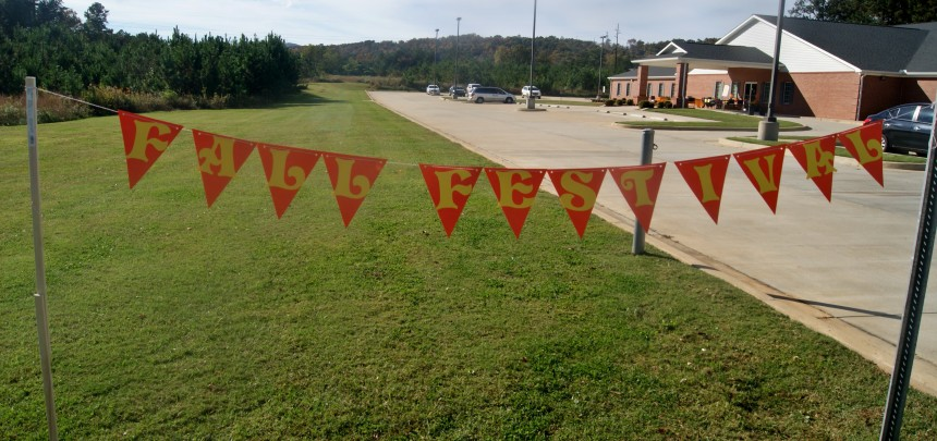 A sign welcomes visitors to the Anniston EI-CRS Fall Festival