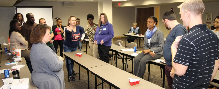 This team-building exercise requires participants to come up with the best strategy to knock over cups of water