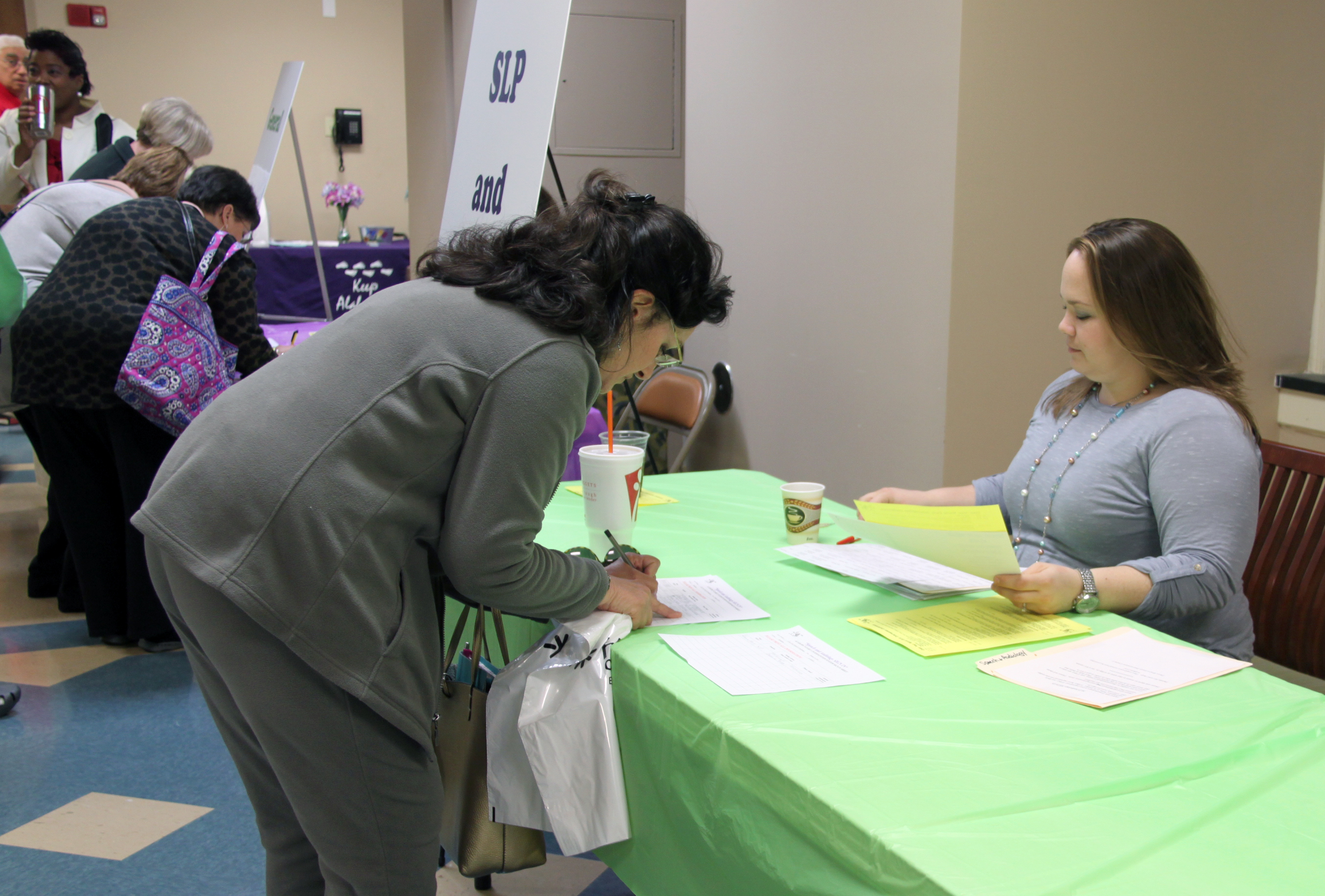 conference offers colorful training for parents providers a conference attendee registers at the social work table