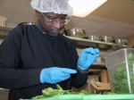 One of the five trainees at The Club preps spinach for the lunch crowd at The Club