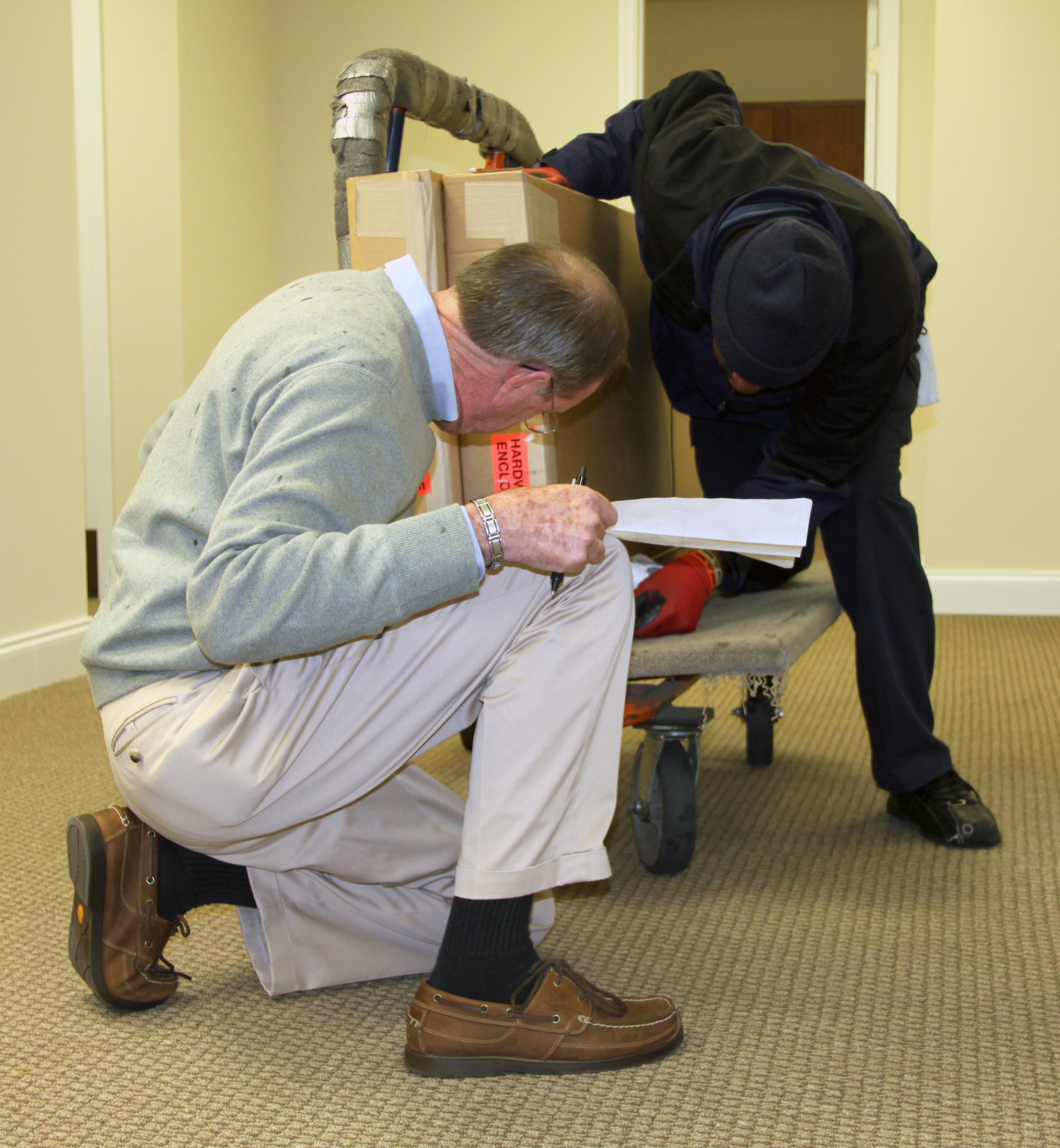 Crawford Slaton, A Representative For Kyser Office Works, Goes Over The  Furniture Shipment