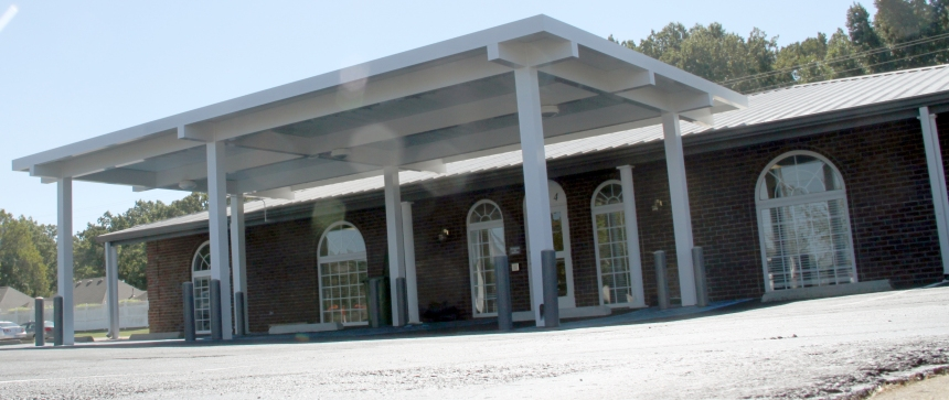 A shot of the exterior of the building, which features covered accessible parking