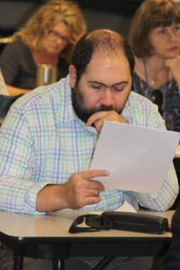 Transition Counselor Paul Pedram looks over a document at the Oct. 11 PETS training in Homewood