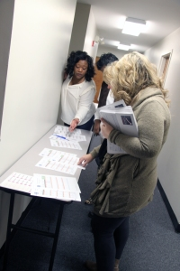Representatives pick up transition materials at the Transition Unlimited meeting in Homewood