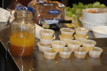 Prepared sauces are dispensed into single-serve ramekins