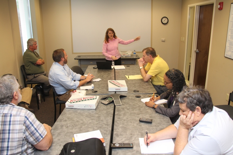 Beverly Floyd leads her first staff meeting since being named the department's software development manager