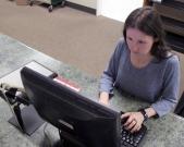 Amanda Sigler, an employee at the Gadsden Public Library, works the circulation desk