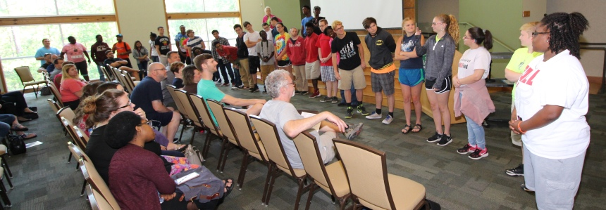 Juniors and seniors from the Alabama School of the Deaf introduce themselves to staff and guests of the retreat