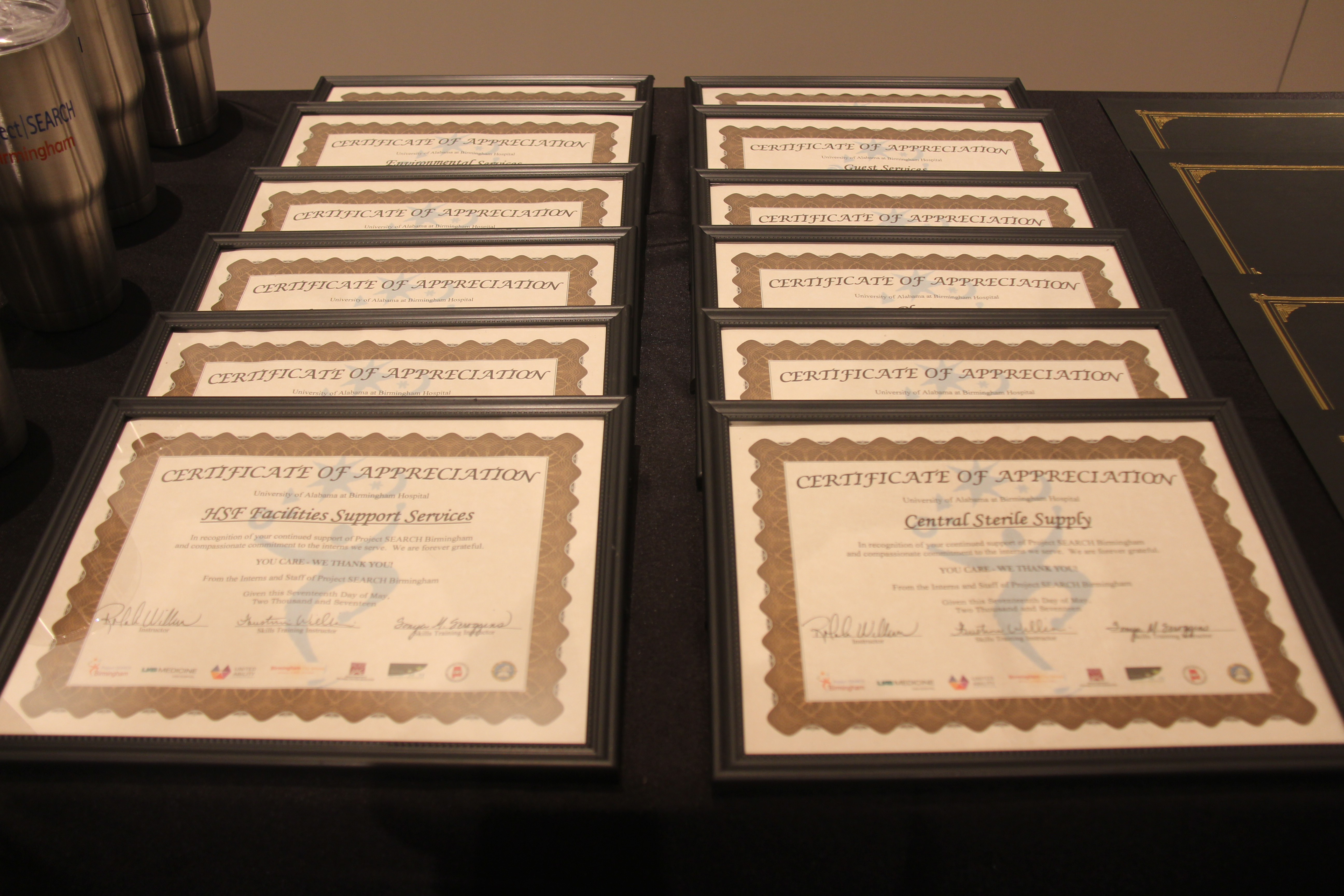 Certificates thanking sponsors and supporters of Project SEARCH in Birmingham were awarded during graduation
