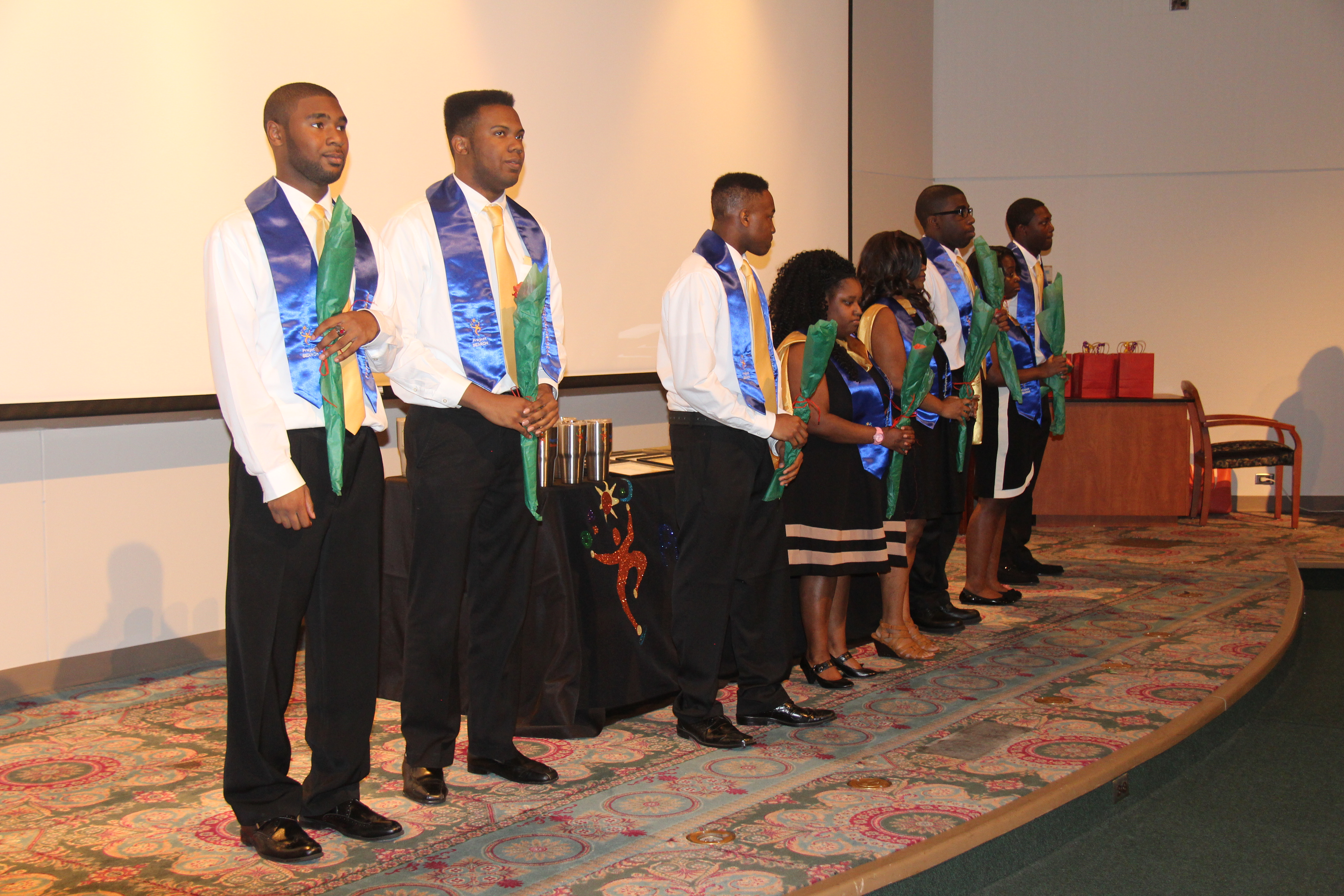Project SEARCH graduates from the UAB site stand on stage
