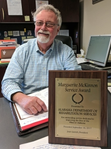 VR Blind/Deaf Assistant Commissioner Curtis Glisson with the Marguerite McKinnon Service Award presented to ADRS staff