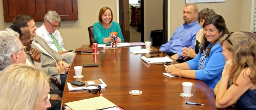 """Dawson is welcomed in a symbolic """"changing of the guard"""" by fellow ELT members during their Sept. 18 meeting"""