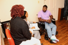 VR Counselor Harriet James and SAIL Case Manager Sherrita Williams discuss future plans with Ronald Witherspoon