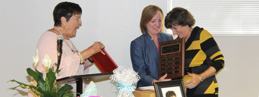 Peggy Anderson is presented the VIP award from Lamona Lucas