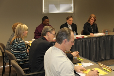 ADRS Board Secretary LeAnne Bull sits to the left of Commissioner Cary Boswell during a board meeting that occurred on March 7, 2014