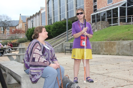 In this file photo, Annie Park meets with VR Counselor Dena Dodd on the University of North Alabama campus in Florence. Orientation and mobility training helps her to properly navigate campus to get to class on time
